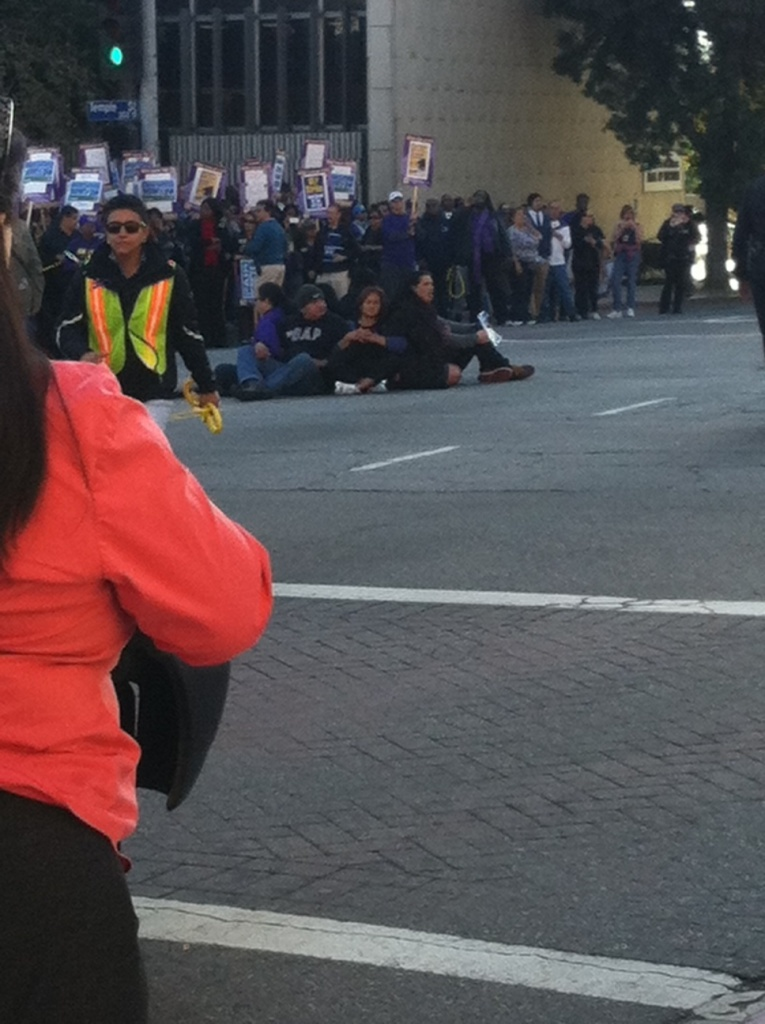 L.A. County social workers and supporters are seen in the street during a sit-in protest Thursday, December 10, 2013. Seven people were arrested.