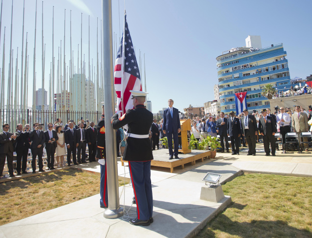Secretary of State John Kerry, and other dignitaries watch as U.S. Marines raise the U.S. flag over the newly reopened embassy in Havana, Cuba. Friday, Aug. 14, 2015. Kerry traveled to the Cuban capital to raise the U.S. flag and formally reopen the long-closed U.S. Embassy. Cuba and U.S. officially restored diplomatic relations July 20, as part of efforts to normalize ties between the former Cold War foes.