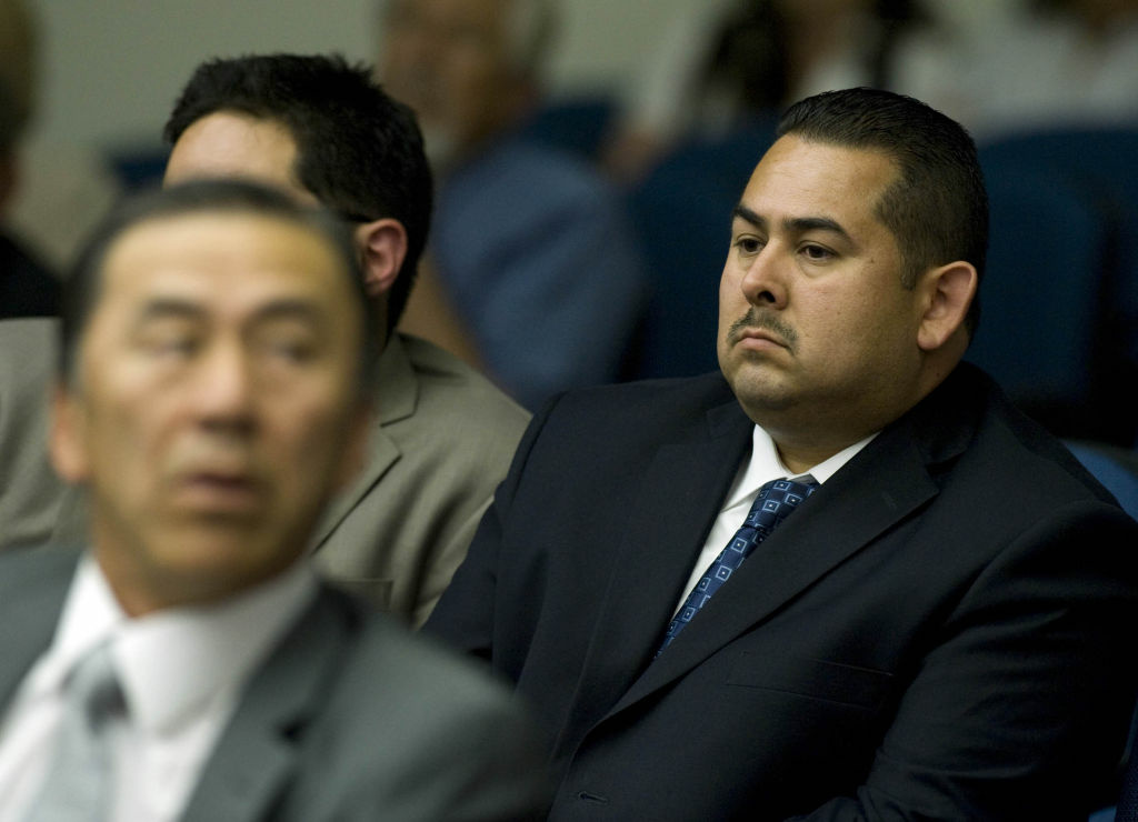 Fullerton police officer Manuel Ramos listens to Tony Rackauckas, Orange County's elected district attorney, during day three of the preliminary hearing into the death of Kelly Thomas. He and another officer are accused in the beating death of Kelly Thomas and are scheduled for arraignment Tuesday morning in a Santa Ana courtroom.