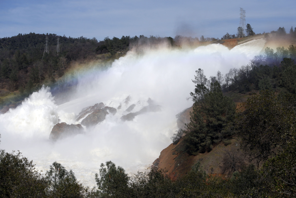 The Oroville Dam spillway overflows with runoff in Oroville, California on February 14, 2017.