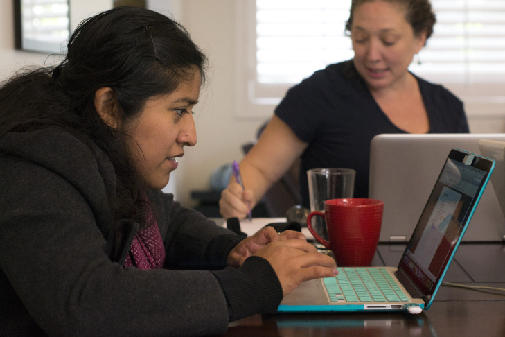 Brenda Nicolas, left, works on updating the Mapping Indigenous LA website with information on Latin American Indigenous diaspora communities with Mishuana Goeman, right.