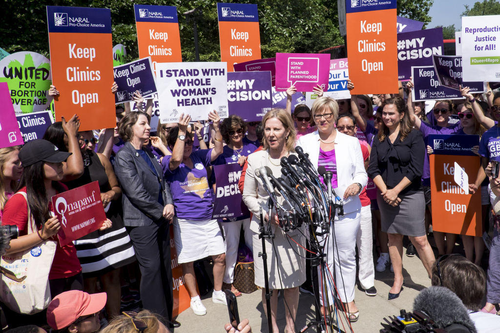 Texas abortion provider Amy Hagstrom-Miller looks on as Nancy Northup, President of The Center for Reproductive Rights speaks to the media outside of the U.S. Supreme Court on June 27, 2016 in Washington, DC.