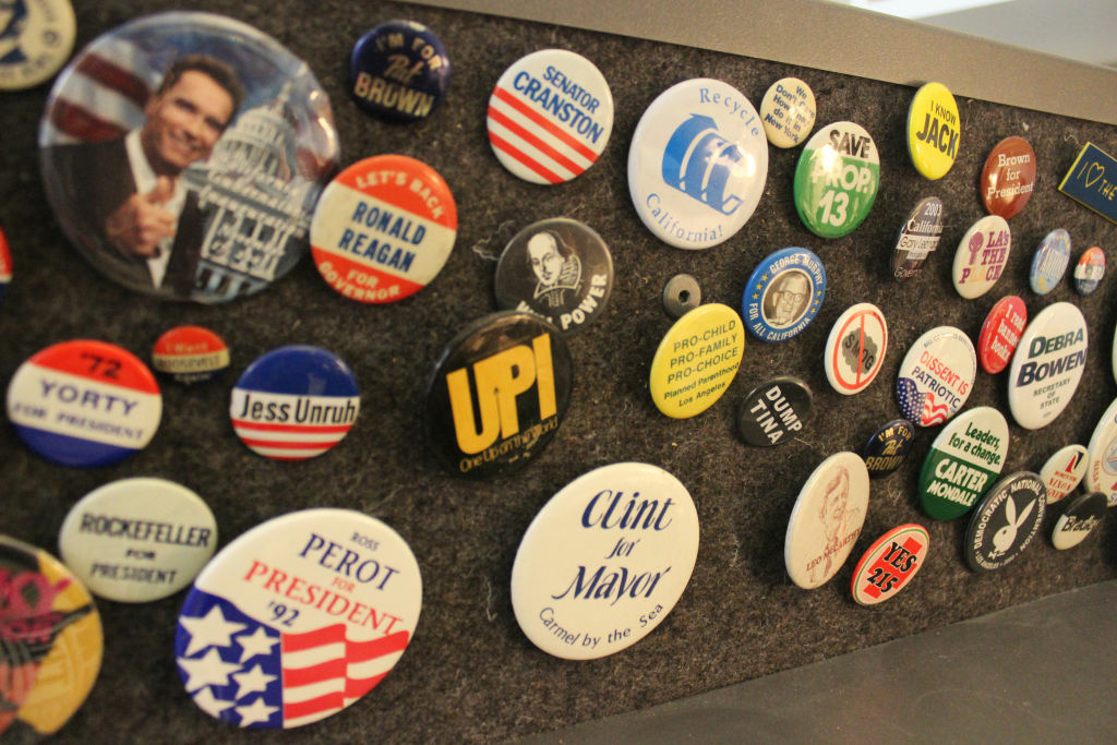 Close up of Patt Morrison's political button collection.