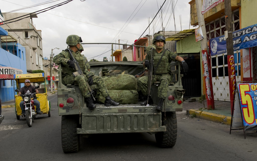 Mexican soldiers patrol along Sor Juana Avenue in Nezahualcoyotl, State of Mexico, Mexico on September 20, 2012.