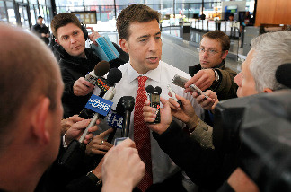 U.S. Senate candidate Alexi Giannoulias fields questions from reporters after being corralled in a post office as he left a rally at the Federal Building Plaza on April 28, 2010 in Chicago, Illinois.