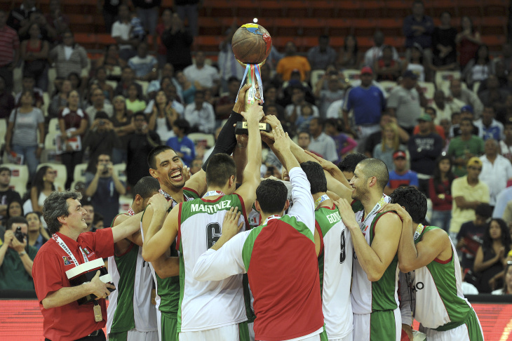 Mexican basketball team player Lorenzo Mata celebrates after defeating Puerto Rico and winning the FIBA Championship game held in Caracas on September 11, 2013. Argentina, Mexico, Puerto Rico and Dominican Republic are the four teams which qualified for the Spain 2014 Basketball World Cup.