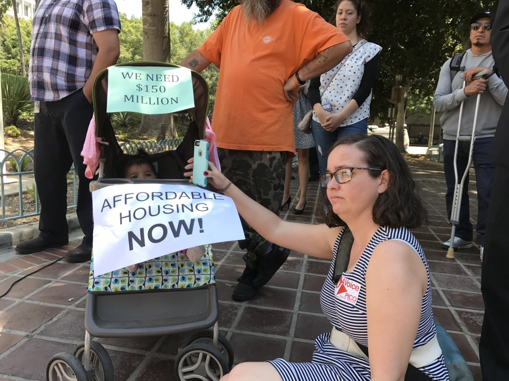 Supporters of a proposed linkage fee on development to help pay for affordable housing rally outside Los Angeles City Hall before a hearing in front of the City Council's planning panel.