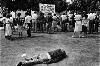 A homeless man sleeps in Gladys Park, 1984.