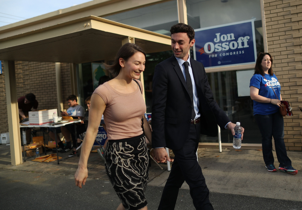 Democratic candidate Jon Ossoff arrives with his girlfriend, Alisha Kramer, at a campaign office as he runs for Georgia's 6th Congressional District on April 15, 2017 in Atlanta, Georgia.