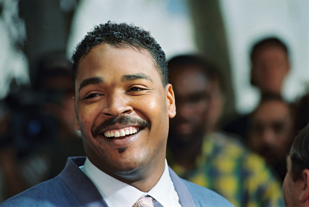 File: Rodney King, the Los Angeles motorist whose beating by police was captured on videotape, smiles, May 1, 1992 in Beverly Hills, during a press conference, where he called for the end of violence in the city.