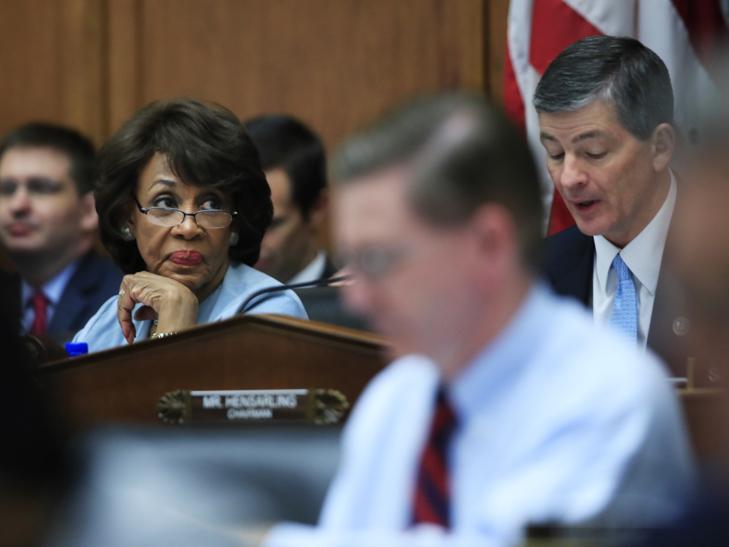 House Financial Services Committee Ranking Member Maxine Waters listens as Committee Chairman Jeb Hensarling speaks on Capitol Hill on May 2, 2017, during the committee's hearing on overhauling the nation's financial rules.
