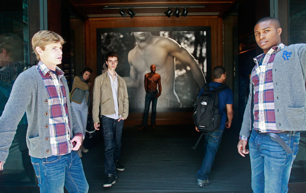 A model at the front entrance to the Abercrombie & Fitch flagship store in New York City.