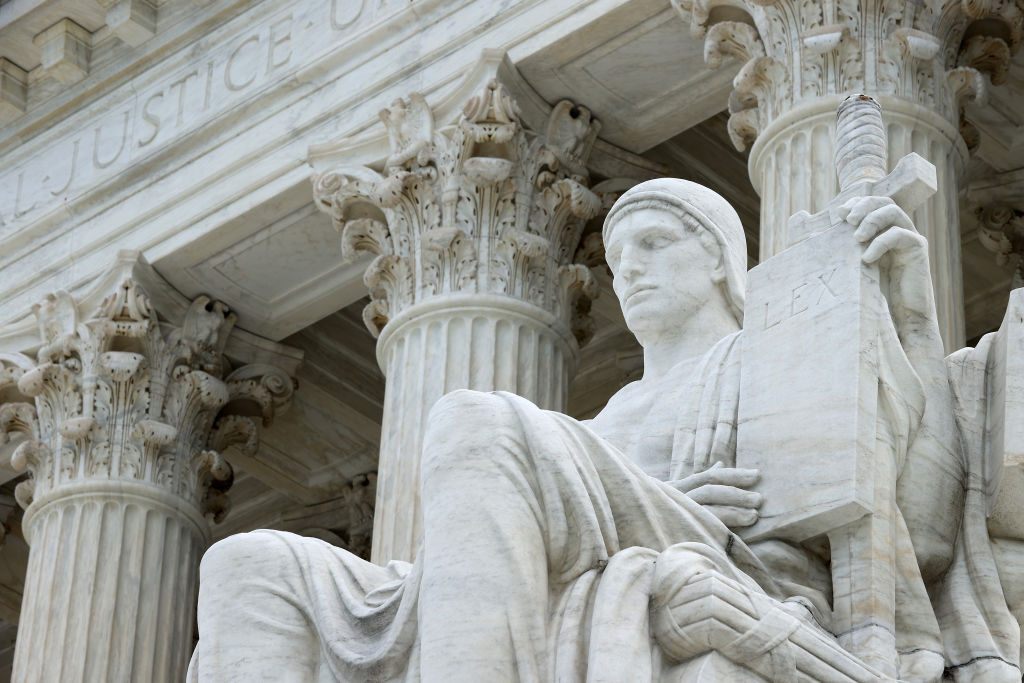 The statue Authority of Law by sculptor James Earle Fraser stands on the steps of the U.S. Supreme Court.