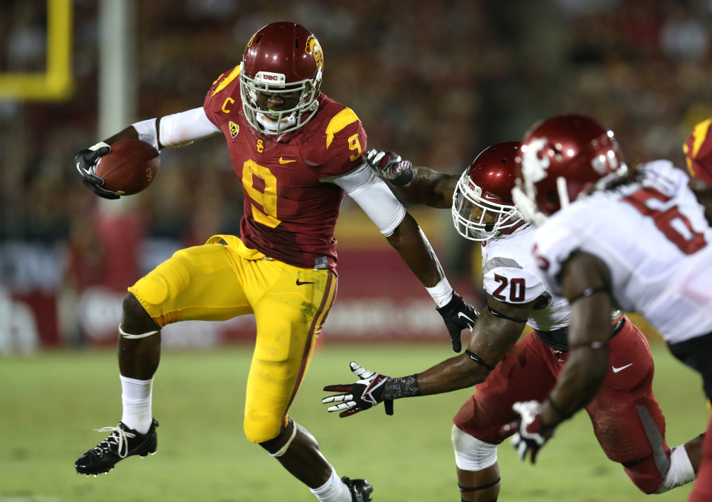 Wide receiver Marqise Lee #9 of the USC Trojans carries the ball against safety Deone Bucannon #20 of the Washington State Cougars at Los Angeles Coliseum on September 7, 2013 in Los Angeles, California. The Cougars won 10-7.