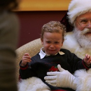 A young boy cries as he has his photo taken with Santa Claus at the Westfield Shopping center on November 28, 2006 in San Francisco, California.