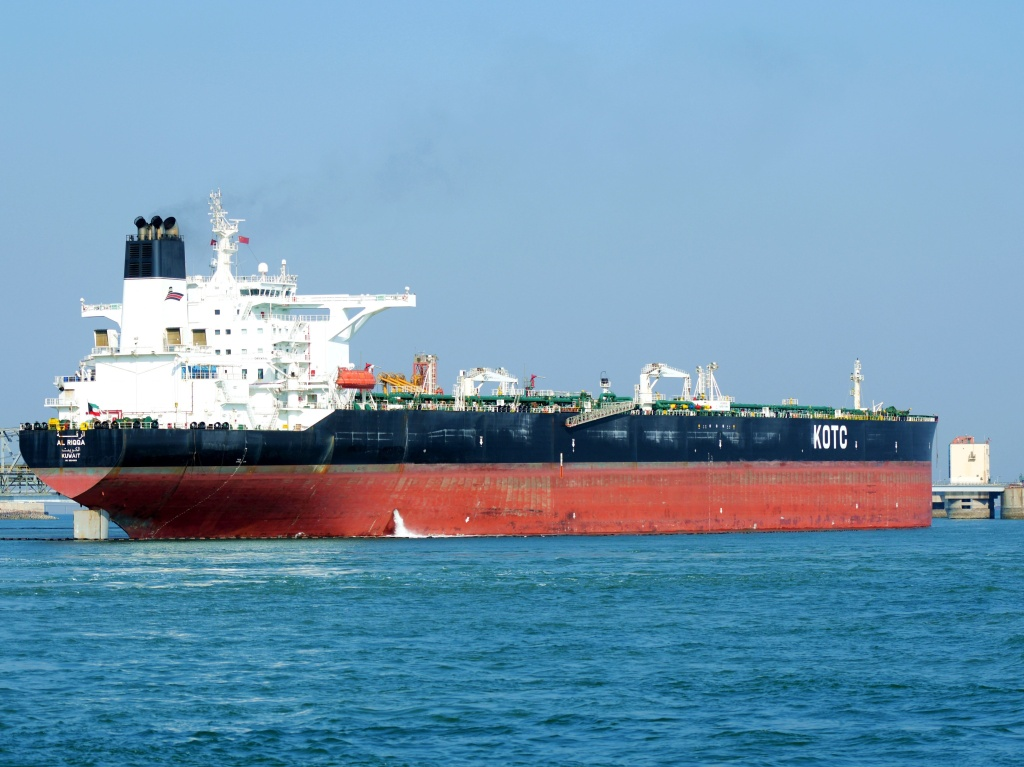Tankers unload imported crude oil at the Qingdao crude oil terminal in east China's Shandong Province in February. A tanker anchored off the port was reportedly hit Tuesday by another vessel, causing an oil spill in the Yellow Sea.