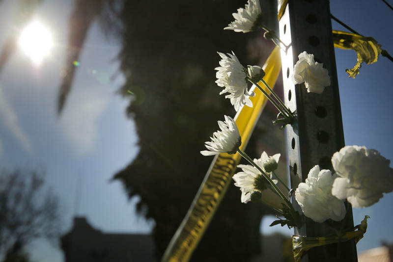 Flowers outside the police line following the fire at Ghost Ship, an Oakland warehouse.
