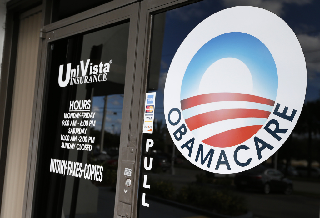 An Obamacare logo is shown on the door of the UniVista Insurance agency in Miami, Florida on January 10, 2017.  As President-elect Donald Trump's administration prepares to take over Washington, they have made it clear that overturning and replacing the Affordable Care Act is a priority. / AFP / RHONA WISE        (Photo credit should read RHONA WISE/AFP/Getty Images)