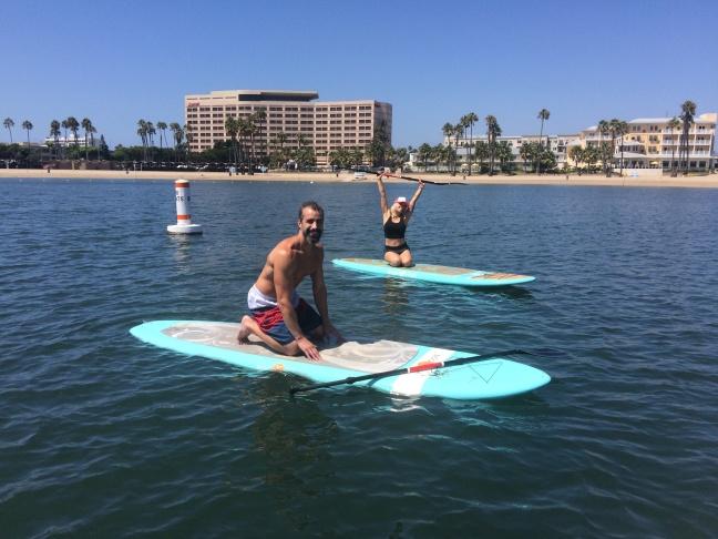 A Martinez with YOGAqua instructor Sarah Tiefenthaler.