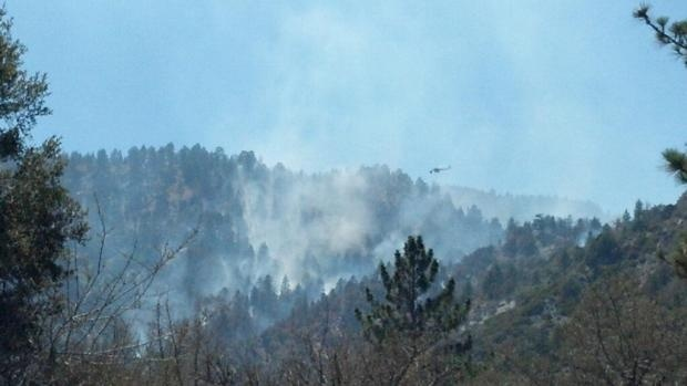 Helicopters assist in fighting the Sharp Fire burning near Wrightwood, Calif.