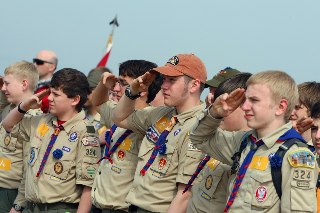 3,000 US Boy scouts salute while listening to the national anthem on April 16, 2011. They arrived to write 'in human letters': 'Normandy Land of Liberty .. 2014' on the Saint-Laurent sur Mer beach, dubbed 'Omaha Beach' during World War II Overlord operation.