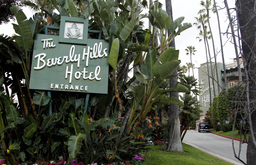 In this April 25, 2012 file photo, the entrance to the Beverly Hills Hotel is seen in Beverly Hills, Calif.  Hollywood is responding to harsh new laws in Brunei by boycotting the Beverly Hills Hotel. The Motion Picture & Television Fund joined a growing list of organizations and individuals Monday, May 5, 2014, refusing to do business with hotels owned by the Sultan or government of Brunei to protest the country's new penal code that calls for punishing adultery, abortions and same-sex relationships with flogging and stoning.