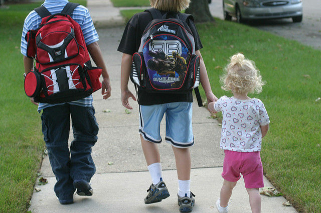 Kids walking to school. For some Southland school districts, the academic year has already begun.