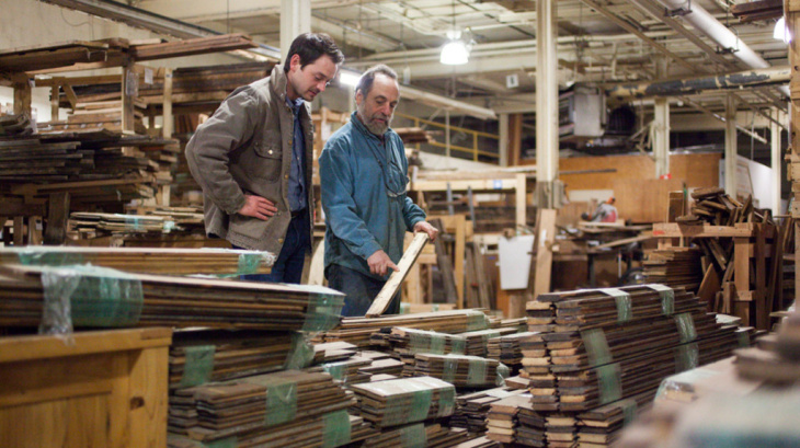 Jeremy Haines (left) is the sales and marketing manager for Reclaim Detroit. The salvage business is just one of the companies helping tear down and reclaim materials from Detroit's many abandoned buildings.