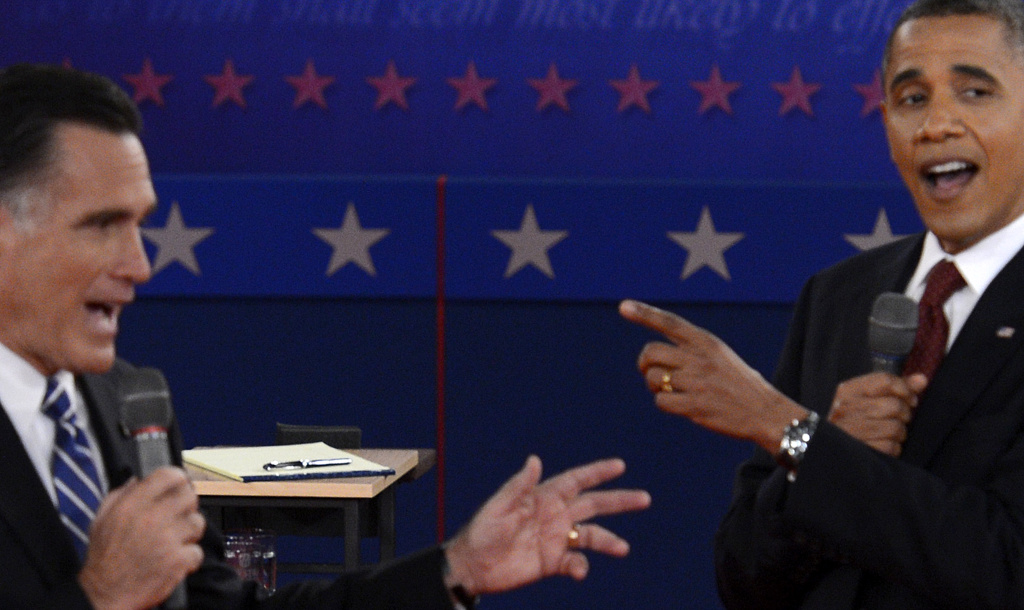 US President Barack Obama (R) and Republican presidential candidate Mitt Romney (L) participate in the second presidential debate, the only held in a townhall format, at the David Mack Center at Hofstra University in Hempstead, New York, October 16, 2012, moderated by CNN's Candy Crowley.