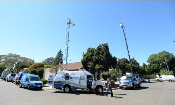 News vans outside alleged anti-Muslim filmmaker Nakula Basseley Nakula's home in Cerritos, CA