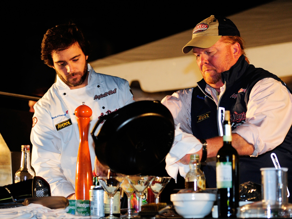 Celebrity chef Mario Batali (R) and Jimmie Johnson (L), driver of the #48 Lowe's Chevrolet, attend the Asphalt Chef Charity Bash at Texas Motor Speedway on November 6, 2010 in Fort Worth, Texas.