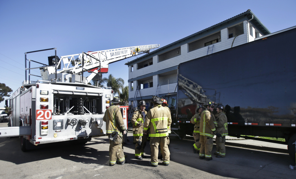 In this Jan. 30, 2013 file photo, firefighters respond to the Heritage Hotel in San Diego, Calif., after a drug-related explosion. There are a growing number of casualties from manufacturing hash oil, a potent marijuana byproduct made with butane. Disasters from the do-it-yourself drug have been recorded around the country in a phenomenon reminiscent of meth lab mishaps, but not as common.