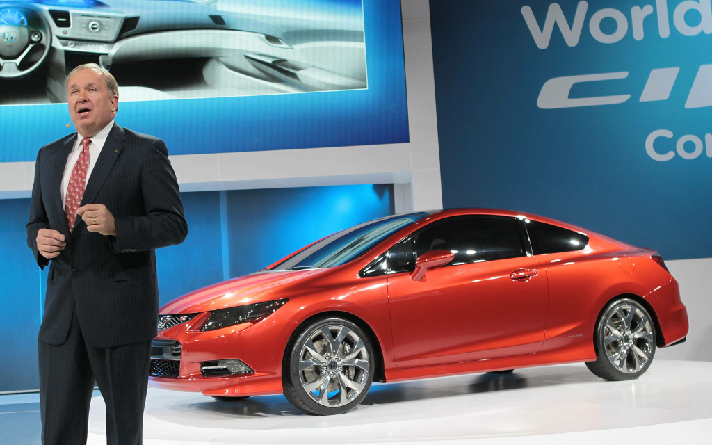 Honda executive John Mendel introduces the new Civic concept during the press preview of the North American International Auto Show at the Cobo Center on January 10, 2011.