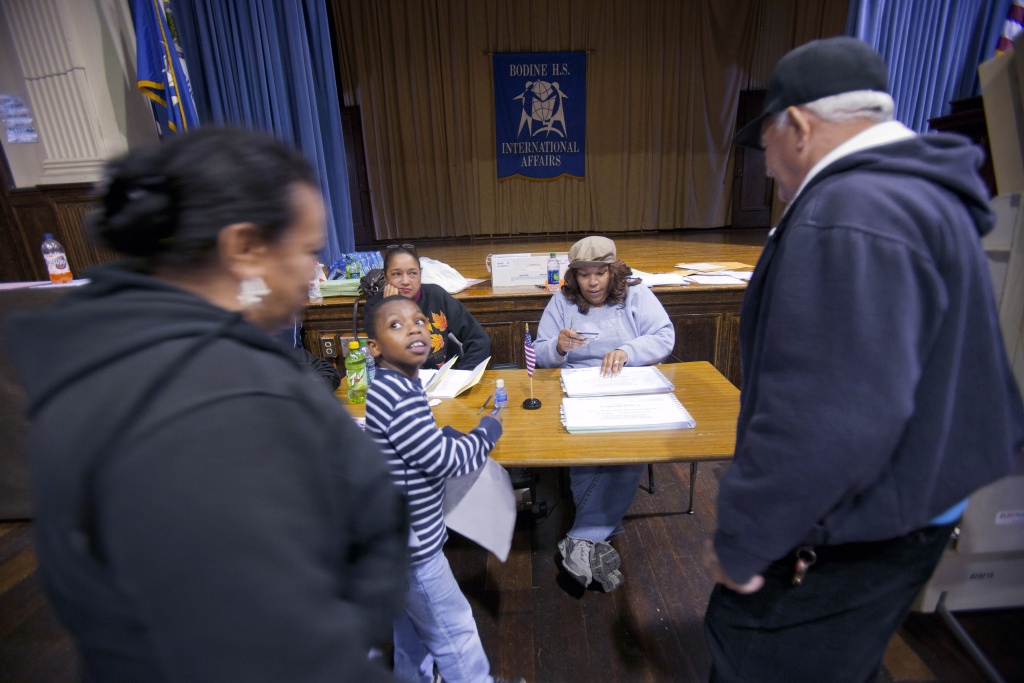 Voters show identification as they sign in to vote during the Republican primary election April 24, 2012 at Bodine High School in Philadelphia, Pennsylvania.
