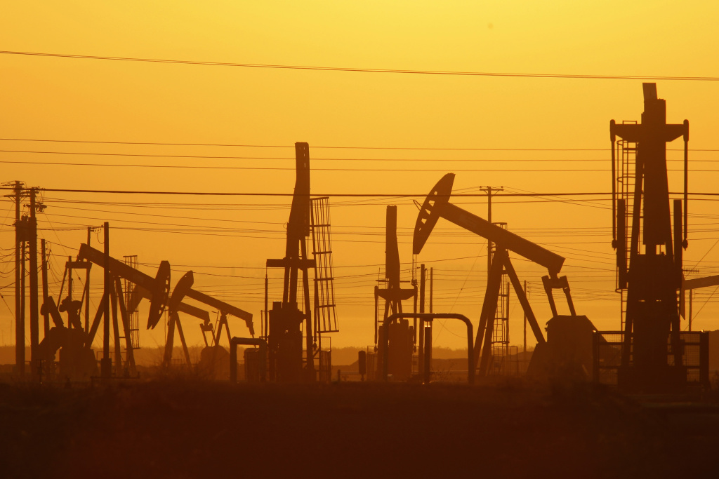 Pump jacks are seen at dawn in an oil field over the Monterey Shale formation where gas and oil extraction using hydraulic fracturing, or fracking.