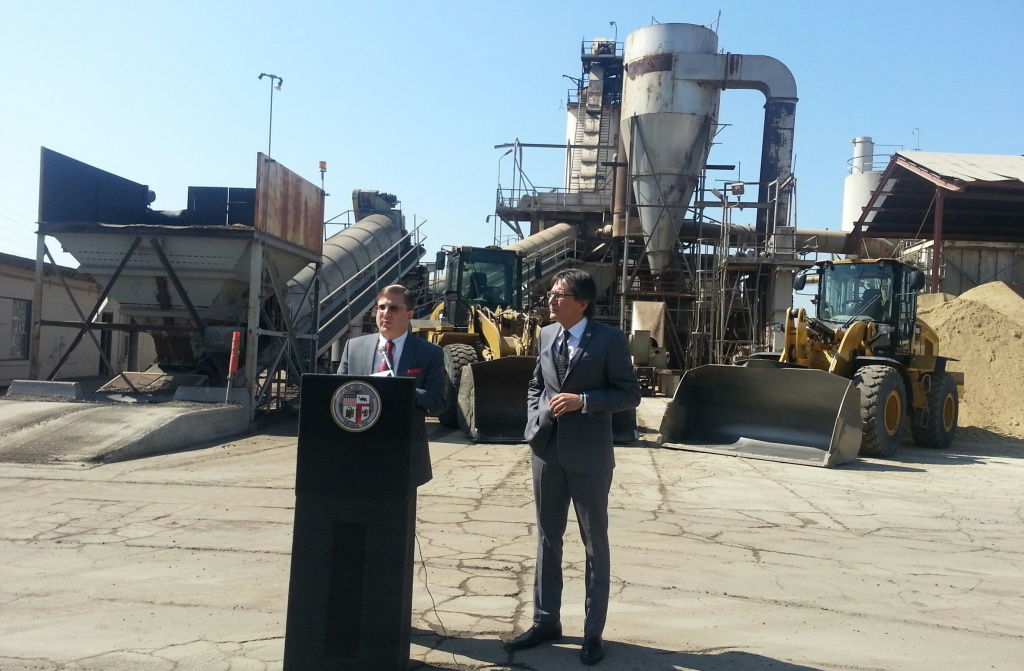 Los Angeles City Controller Ron Galperin speaks outside an asphalt plant as he releases an audit of the city's efforts to fill potholes.
