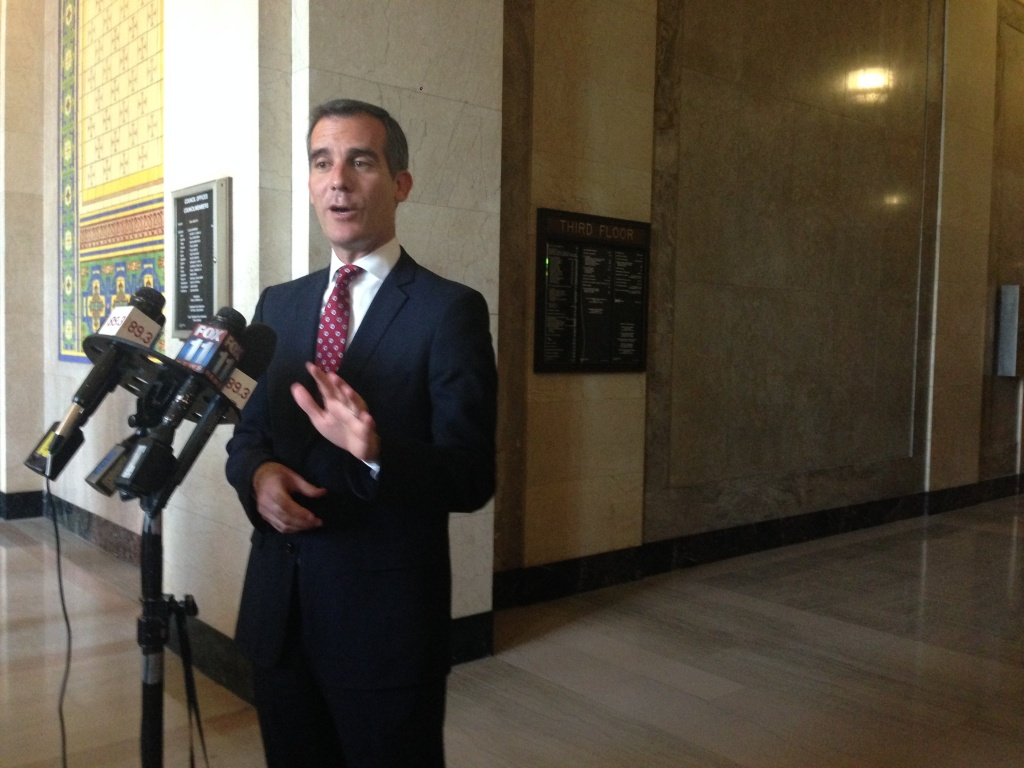 Mayor Eric Garcetti answers the media's questions outside Council Chamber.