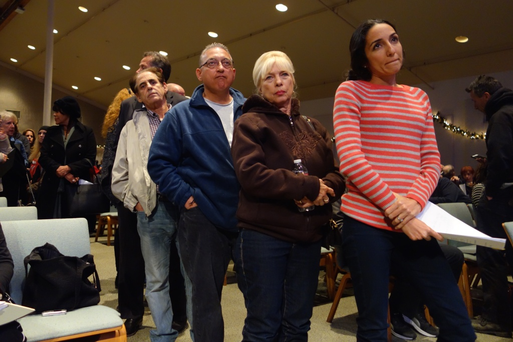 Porter Ranch resident Nicole Abraham, in the red shirt, waits her turn to ask attorneys a question about the massive gas leak at the nearby Aliso Canyon underground gas storage field. That public meeting was in December 2015.