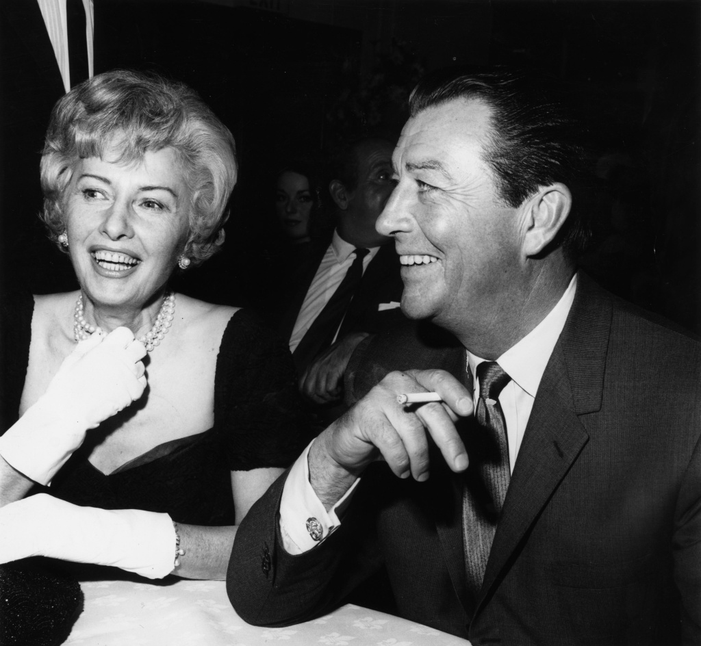 26th May 1964: American film stars Barbara Stanwyck and Robert Taylor who were married in 1939 and divorced twelve years later at a press party to mark the start of production of their new film 'The Night Walker'.