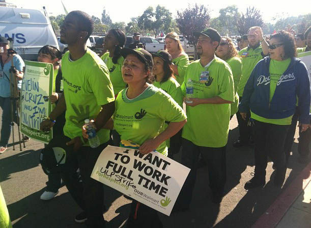 Walmart workers from across SoCal march in front of the Walmart in Paramount, CA.