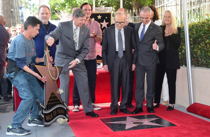 Italian composer Ennio Morricone (C) watches as his Star is unveiled on the Hollywood Walk of Fame during a ceremony on Feb. 26, 2016 in Hollywood.