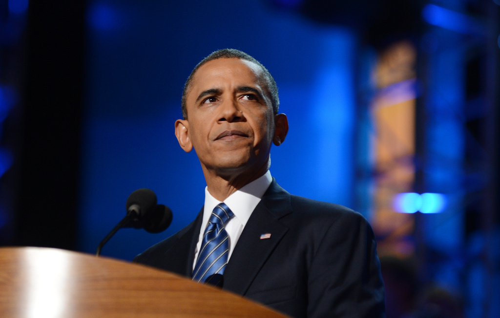 US President Barack Obama pauses during his nomination acceptance speech at the Time Warner Cable Arena in Charlotte, North Carolina, on September 6, 2012 on the final day of the Democratic National Convention.