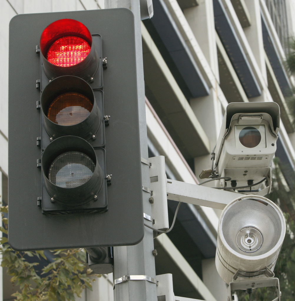 In this Sept. 29, 2010 file photo, a red light camera setup is seen in Los Angeles. The city has since voted to stop using the cameras for enforcement. Riverside is set to decide the same issue on Tuesday.
