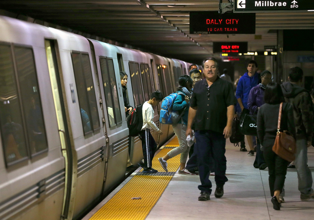 File: Bay Area Rapid Transit (BART) passengers walk off of a train on Oct. 15, 2013 in San Francisco.