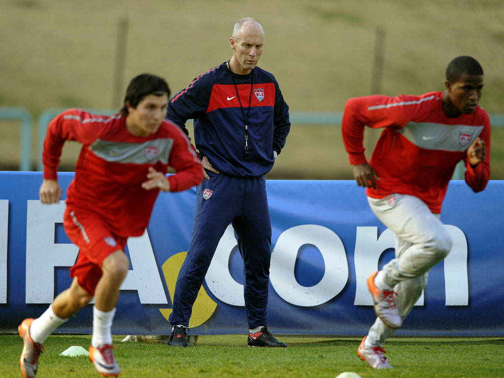 U.S. coach Bob Bradley watches over his players.