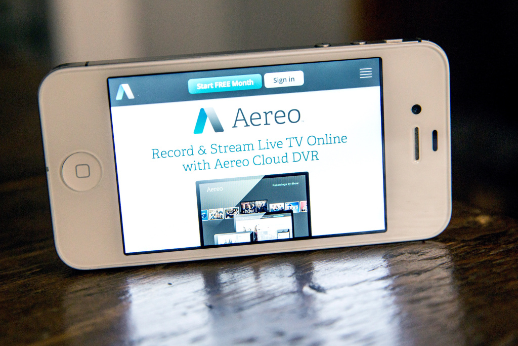 In this photo illustration, Aereo.com, a web service that provides television shows online, is shown on an iPhone 4S on April 22, 2014 in New York City.