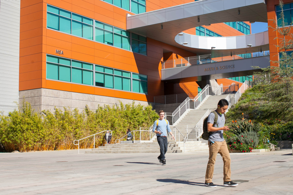 File: Students walk on campus at West Los Angeles College in Los Angeles on Thursday, Nov. 3, 2016.