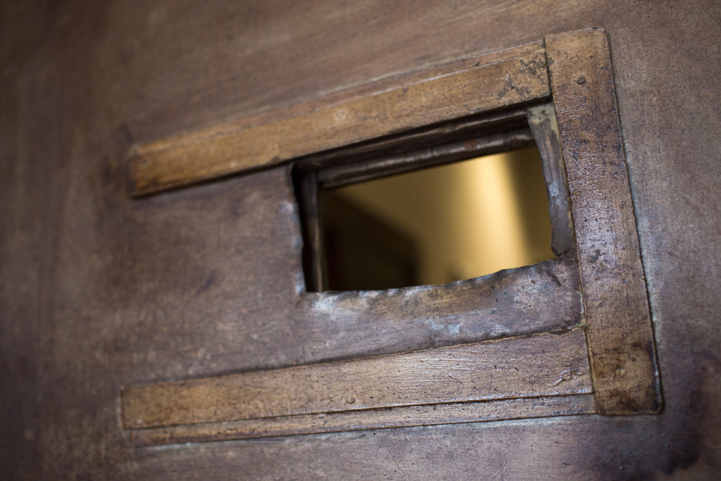 A hole cut out in this wooden door is a remnant of a speakeasy that opened inside the Italian Hall during Prohibition in the 1920s and early 1930s.