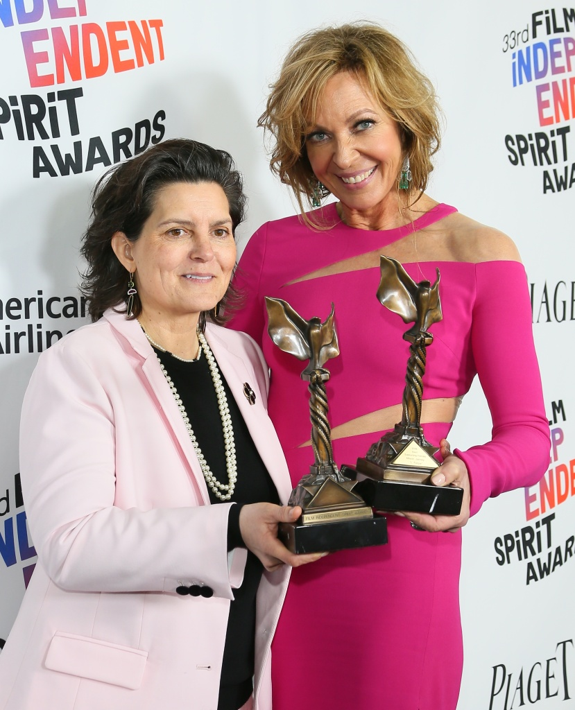 Film editor Tatiana S. Riegel and actor Allison Janney pose with their awards for