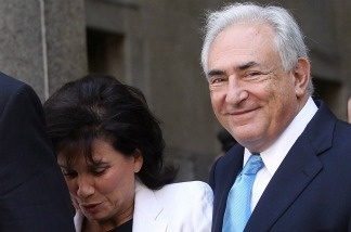 Former International Monetary Fund leader Dominique Strauss-Kahn (R) and his wife Anne Sinclair leave New York State Supreme Court for a hearing on July 1, 2011 in New York City.
